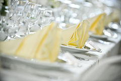 White tablecloth settings. A table set with a white tablecloth and napkins Stock Images