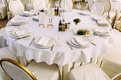 White tableclothes on the wedding tables. A Stock Photos