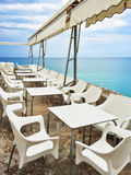 White tables in a cafe by the seaside Stock Image