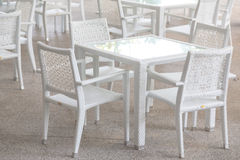 White tables and chairs Stock Photo