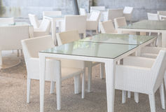 White tables and chairs Stock Images
