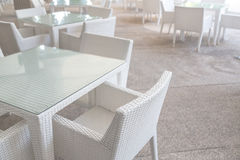 White tables and chairs Royalty Free Stock Images
