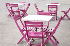 White tables and pink chairs Stock Images