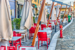 white tables and red chairs in outdoor bar Stock Photos