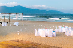 White tables served for supper on beach. Royalty Free Stock Photos
