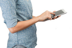 White tablet with a blank empty screen in the hands Stock Image