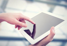 White tablet with a  blank screen in the hands Stock Photography