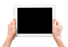 White tablet computer with a black blank screen in the human  ha. White tablet computer with a black blank screen in thehuman hands  isolated on white background Stock Images