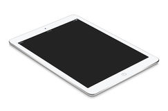 White tablet computer with blank screen mockup lies on the surfa Stock Images