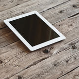 White tablet computer with cup coffe Stock Photography