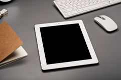 White tablet computer on a gray surface Stock Photo