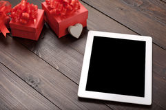 White tablet computer with red gift box Stock Photo