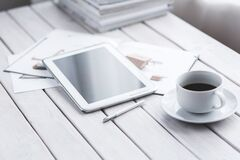 White tablet and cup of coffee Stock Photo