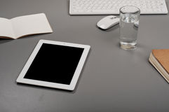 White tablet with a glass of water Stock Images