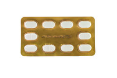 White tablet in gold blister pack Royalty Free Stock Photo
