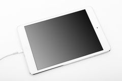 White tablet laying on white background Royalty Free Stock Photos