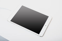 White tablet laying on white background Stock Photography