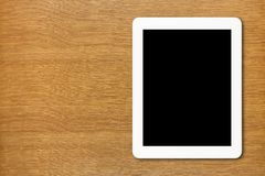 White Tablet PC with black screen on the table Royalty Free Stock Image