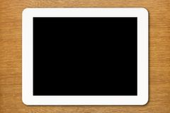 White Tablet PC with black screen on the table Stock Photo