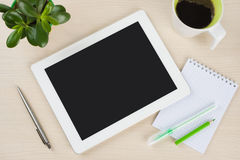 White tablet pc with notes, pen and coffee cup on desk Stock Photos