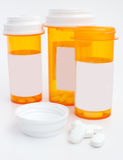White tablets and medication containers copy space Stock Image