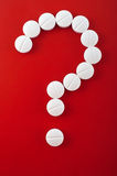 White tablets on red background as question mark Royalty Free Stock Photos