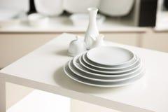 White tableware stylish luxury crockery. Hotel restaurant white dishes assortment. Stylish crockery set. Luxury and sophistication concept Royalty Free Stock Photography