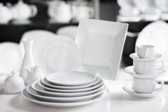 White tableware stylish luxury crockery. Hotel restaurant white dishes assortment. Stylish crockery set. Luxury and sophistication concept Stock Photos