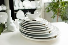 White tableware stylish luxury crockery. Restaurant white tableware assortment. Stylish crockery set. Purity and luxury concept Royalty Free Stock Photo