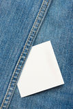 White tag on blue jeans background Stock Images