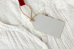 White tag on the clothes Royalty Free Stock Photography
