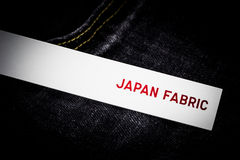 White tag. On jean background Stock Image