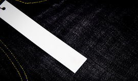 White tag. On jean background Stock Photo