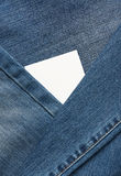 White tag between jeans cloth Royalty Free Stock Photo