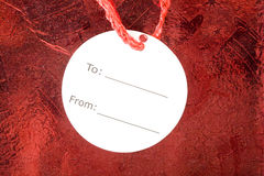 White Tag on Red Present Royalty Free Stock Photography