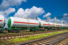 White tank cars. Railroad transportation white tank cars with oil stock photos