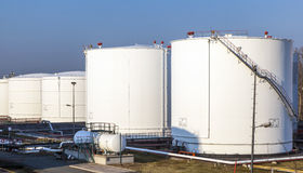 White tank in tank farm. With blue sky royalty free stock image
