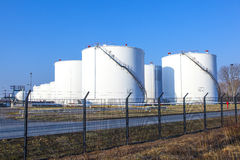 White tank in tank farm with blue sky Royalty Free Stock Photo
