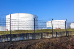 White tank in tank farm with blue Stock Images