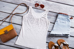 White tank top and purse. Royalty Free Stock Photos
