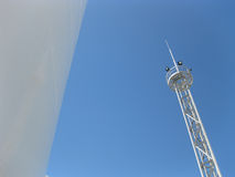 White tank and tower lighting on the sky background. Royalty Free Stock Image