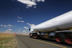White Tanker Truck. Transporting fuel along the tar highway Stock Photography