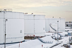White Tanks In Tank Farm With Snow In Winter Royalty Free Stock Photography