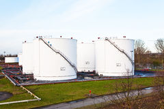 White tanks for petrol and oil. In tank farm with blue sky stock photography