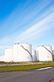 White tanks for petrol and oil in tank farm. With blue sky stock photos