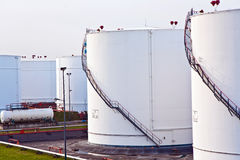 White tanks for petrol and oil in tank farm Royalty Free Stock Image