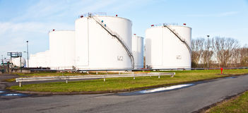 White tanks for petrol and oil in tank farm Stock Photo