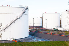 White tanks for petrol and oil in tank farm Stock Photography