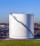 White tanks in tank farm with blue Royalty Free Stock Photos