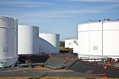 White tanks in tank farm with blue Royalty Free Stock Image